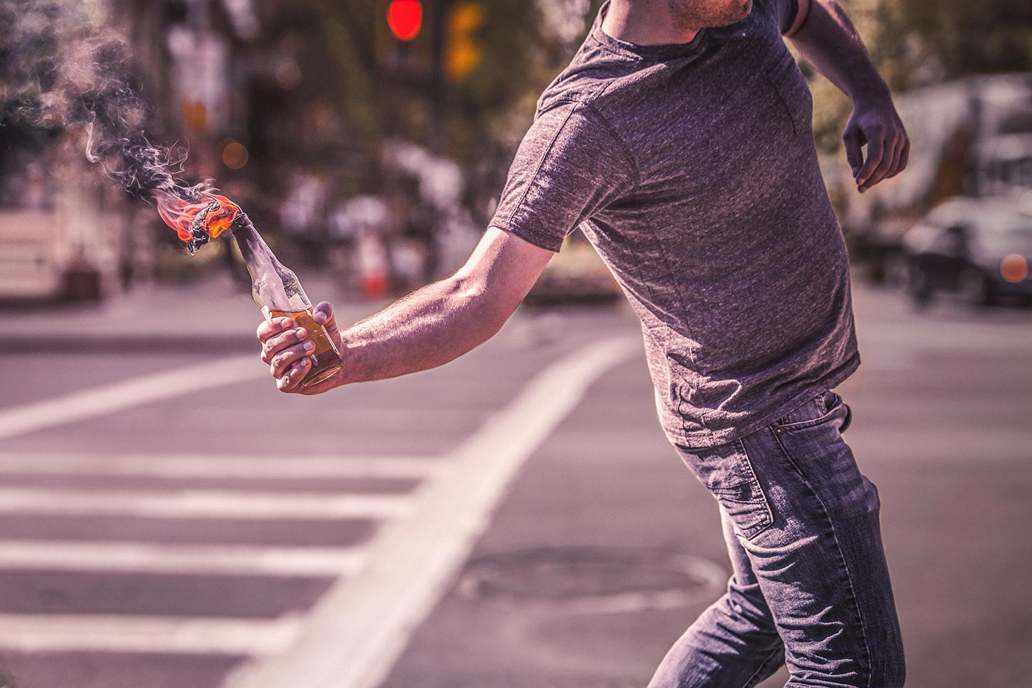 man throwing a molotov cocktail, anarchy